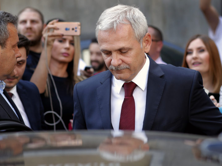 epa06739039 Liviu Dragnea (C) the president of the Romanian Parliament's Deputy Chamber and the leader of the main ruling party PSD (Social Democracy Party) prepares to enter his car as he leaves the High Court of Cassation and Justice of Romania (ICCJ) headquarters, after the last hearing, in Bucharest, Romania, 15 May 2018. DNA (National Anti-graft Directorate) prosecutors have demanded seven and a half years in prison for Dragnea in the file called 'DGASPC', in which the President of Chamber of Deputies, Liviu Dragnea, was accused of instigating to abuse of public function and of incitement to intellectual forgery. The verdict for this case was postponed to 29 May.  EPA-EFE/ROBERT GHEMENT