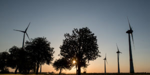 epa06756602 Wind turbines during sunny evening on a field near Neubrandenburg, Northern Germany, 23 May 2018. Meteorologist predict the cloudy weather with temperatures around 24 degrees Celsius in the next days in Northern Germany.  EPA-EFE/FILIP SINGER