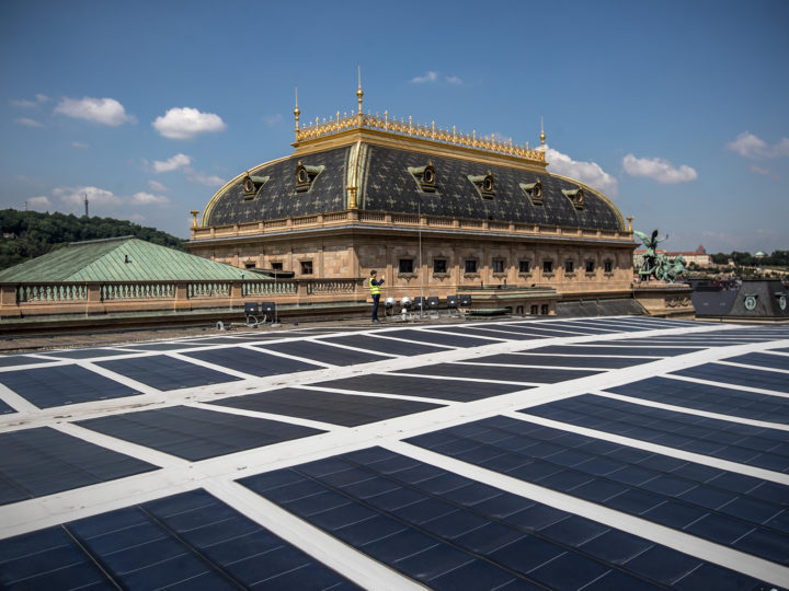 epa06762190 A man stands behind solar panels on the roof of the Czech National Theatre building in Prague, Czech Republic, 25 May 2018. The National Theatre had installed solar panels on its roof in order to save money from the electrical power costs.  EPA-EFE/MARTIN DIVISEK