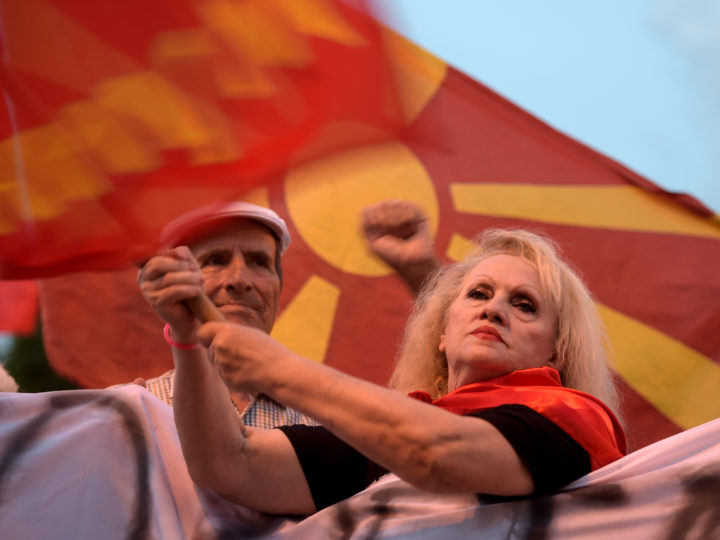 epa06805591 Protestors wave flags and shout slogans during an anti-government protest in front of the Parliament building in Skopje, The Former Yugoslav Republic of Macedonia (FYROM), 13 June 2018. Demonstrators protested the government's politics as well as against a compromise solution in Macedonia's dispute with Greece over the country's name.  EPA-EFE/NAKE BATEV