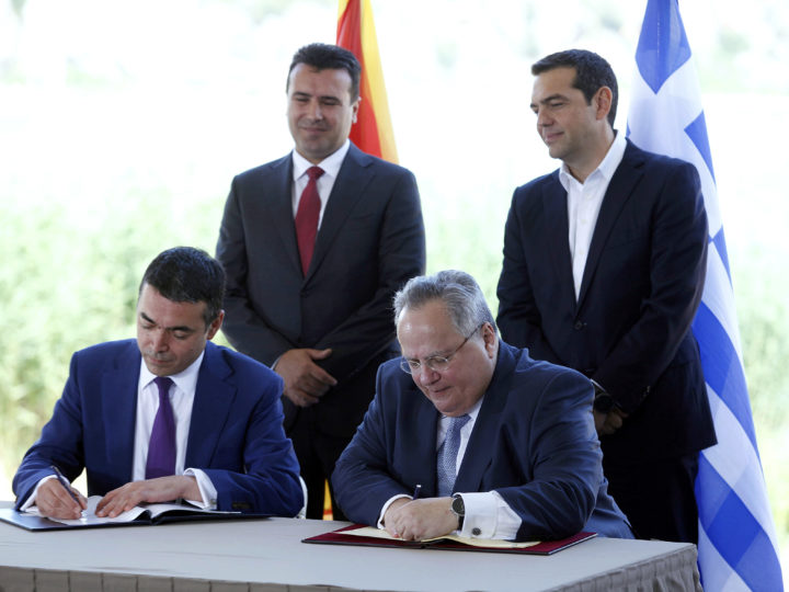 epa06814994 Greek Prime Minister Alexis Tsipras (back- R) and FYROM Prime Minister Zoran Zaev (back- L) watch foreign ministers of Greece, Nikos Kotzias (front- R) and Former Yugoslav Republic of Macedonia (FYROM), Nikola Dimitrov (front- L) signing an agreement in the village of Psarades, Florina, Greece, 17 June 2018. The foreign ministers of Greece and the Former Yugoslav Republic of Macedonia (FYROM), Nikos Kotzias and Nikola Dimitrov, and the UN Secretary General's Special Envoy for the name dispute signed a historic agreement on 17 June 2018 for resolving the decades-long issue during a lakeside signing ceremony in Prespes, where th EPA-EFE/NIKOS ARVANITIDIS