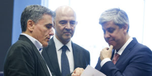 epa06827534 (L-R) Greek Finance Minister Euclid Tsakalotos,  European Commissioner for Economic and Financial Affairs, Pierre Moscovici and The President of the Eurogroup, Portuguese Finance Minister Mario Centeno during a meeting of the Eurogroup in Luxembourg, 21 June 2018. The Eurogroup will assess the progress achieved by Greece in implementing the prior actions required under the fourth (and the final) review of its programme.  EPA-EFE/JULIEN WARNAND