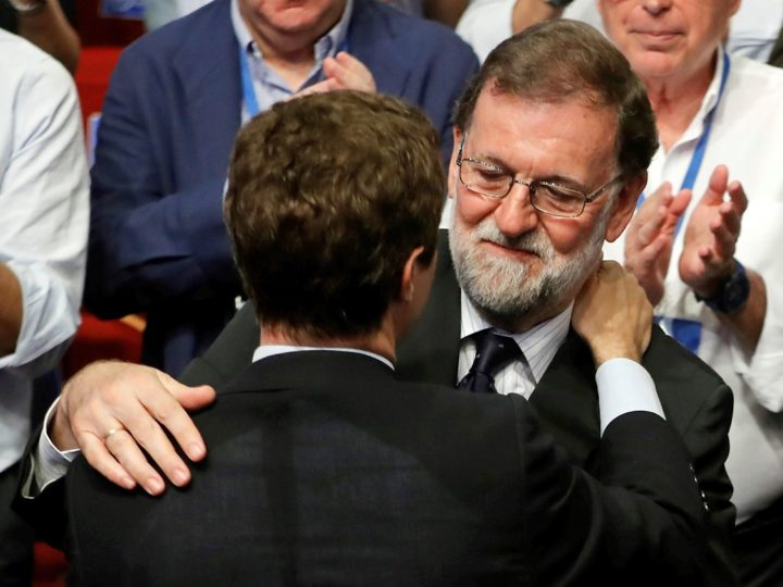epa06902537 The new President of the Spanish conservative People's Party (PP), Pablo Casado (L, back to camera), is congratulated by his predecessor former Prime Minister and PP party leader Mariano Rajoy (R) at the People's Party (PP) national congress, in Madrid, Spain, 21 July 2018. Media reports state that Casado, 37, received a majority of 57 percent of the delegates' votes, while the other candidate, former deputy Prime Minister Soraya Saenz de Santamaria, gained some 42 percent of the votes of the PP delegates.  EPA-EFE/JUAN CARLOS HIDALGO