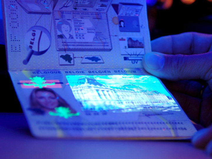 epa01203542 (FILES) The file picture, dated 28 November 2007, shows a  German policeman examining a Belgian passport under a special light at the border crossing Waidhaus, Germany. Starting 21 December 2007 the border controls at the 356km long border between Bavaria and the Czech Republic will be discontinued, as the two new members states Poland and Czech Republic join the Schengen Agreement. This allows for the free flow of people between the two countries once separated by the Iron Curtain.  EPA/Armin Weigel