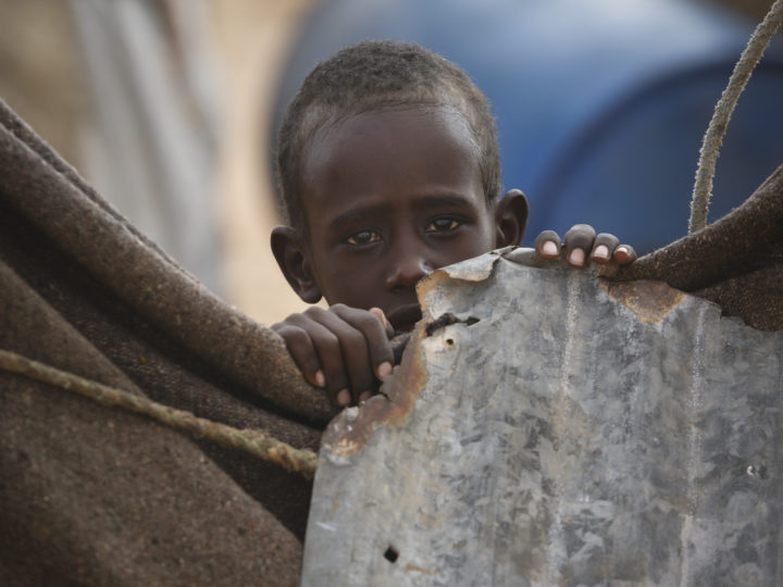 epa05873313 A photograph made available on 27 March 2017 shows a young Internally Displaced Person (IDP) looking on from his family?s makeshift shelter in an IDP camp in the outskirts of Qardho in Somalia's semi-autonomous region of Puntland, Somalia, 26 March 2017. The food crisis caused by lack of rainfall in the region affects 5.6 million people in Ethiopia according to the Red Cross, which aims to raise 13.8 million US dollars to 'provide food for tens of thousands of people, screen children for malnutrition, and improve access to health services and clean water'. East Africa has been suffering from a severe drought since 2015 due to the El Nino weather phenomenon.  EPA/DAI KUROKAWA