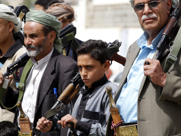 epa06838636 Supporters of Houthi rebels shout slogans and hold up weapons during a gathering to mobilize more fighters into the port city of Hodeidah, in Sana'a, Yemen, 25 June 2018.  According to reports, the Saudi-led coalition intensified its three-year bombing campaign against several positions of the Houthi rebels and their allies in the port city of Hodeidah as the Houthi rebels continued to mobilize more tribal fighters into Hodeidah battlefront against Yemen?s Saudi-backed government forces.  EPA-EFE/YAHYA ARHAB