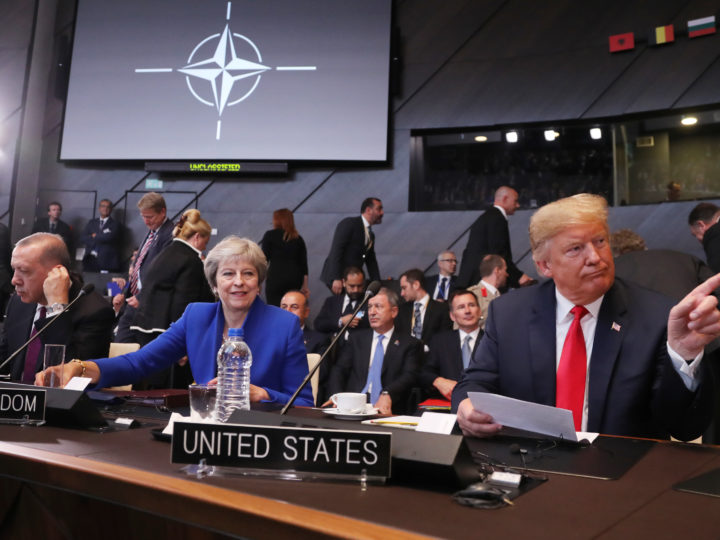 epaselect epa06880334 (L-R) Turkey's President Recep Tayyip Erdogan, British Prime Minister Theresa May and US President Donald J. Trump (C) before the start of the North Atlantic Council round table during a NATO summit in Brussels, Belgium, 11 July 2018. NATO countries' heads of states and governments gather in Brussels for a two-day meeting.  EPA-EFE/OLIVIER HOSLET