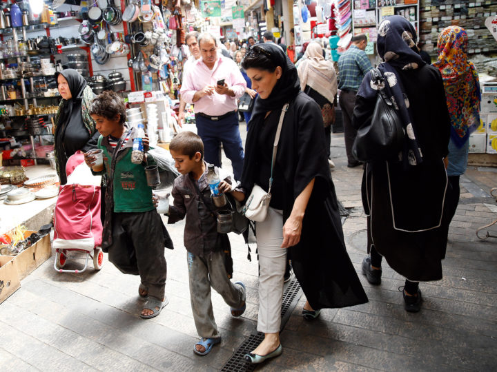 epa06907481 Child vendors walk in a bazaar in Tehran, Iran, 24 July 2018. US President Donald Trump on 23 July warned his Iranian counterpart Hassan Rouhani against threatening the US, adding that there could be severe consequences. Rouhani had asserted that his country was not seeking to start hostilities with the US, but it would not shy away from a fight.  EPA-EFE/ABEDIN TAHERKENAREH