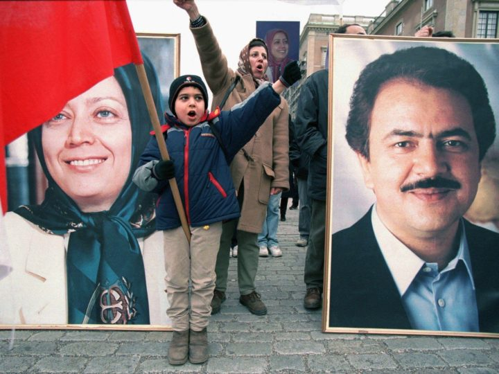 "STO01 - 20010412 - STOCKHOLM, SWEDEN: A young Iranian child shouts slogans standing in front of a portrait of Maryam Rajavi (L) and Masoud Rajavi (R), leaders of the National Council of Resistance of Iran, as some 150 Iranian activists protest Thursday, 12 April 2001 in downtown Stockholm to protest what they claim a new wave of executions and arrests in their home country Iran. They carried signs with slogans like ""EU: It's time to cut ties with the mullahs"" and ""We call for trial of the mullah criminal leaders by an international tribunal"". EPA PHOTO PRESSENS BILD/HENRIK MONTGOMERY (FILM)"