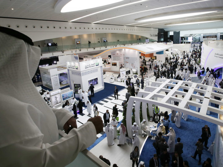 epa05017924 A man watches the exhibition of Abu Dhabi International Petroleum Exhibition and Conference (ADIPEC) in Abu Dhabi, United Arab Emirates, 09 November 2015. ADIPEC, a meeting place of the international oil and gas community, runs between 09 and 12 November 2015.  EPA/ALI HAIDER