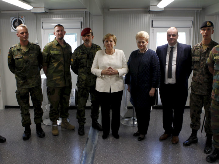 epa07020294 German chancellor Angela Merkel (C-L) and Lithuanian President Dalia Grybauskaite (C-R) meet senior representatives of the countries participated in the NATO Enhanced Forward Presence multinational battalion battle group during her visit to Rukla, Lithuania, 14 September 2018. German troops led NATO Enhanced Forward Presence multinational battalion battle group in Lithuania. German chancellor Angela Merkel is on a one day visit to Lithuania.  EPA-EFE/TOMS KALNINS