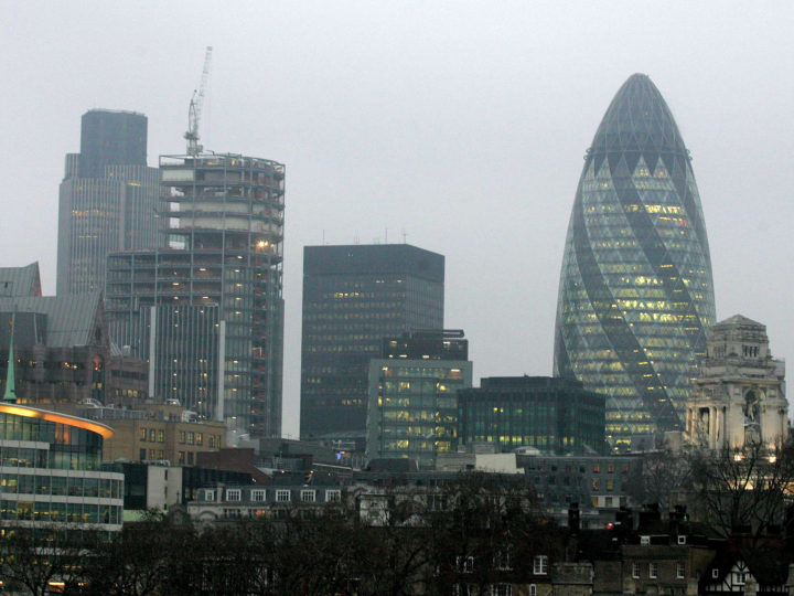 epa04334703 (FILE) A file photo dated 05 February 2007 showing the office building 30 St Mary Axe, also known as the Gherkin Tower (R), a well-known landmark of London, Britain. Reports on 29 July 2014 state the building, that in April 2014 was placed in receivership in April 2014 after one of its two owners the German IVG Immobilien was placed in insolvency in 2013, is for sale and expected to reach a price level of an estimated 650 million pounds. Real estate companies Deloitte Real Estate and Savills are jointly marketing the building that was designed by designed by Norman Foster of the Foster and Partners architecture company.  EPA/LINDSEY PARNABY