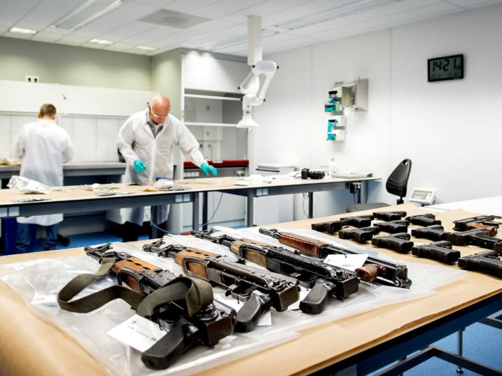 epa04855514 A large number of rifles, hand guns, automatic machine-guns, and ammunition are displayed on a table in a police office in Driebergen, the Netherlands, 21 July 2015. The weapons were found in a garage in Nieuwegein, and several arrests have been made. The police states this constitutes one of the largest ever weapon recoveries in Holland.  EPA/KOEN VAN WEEL