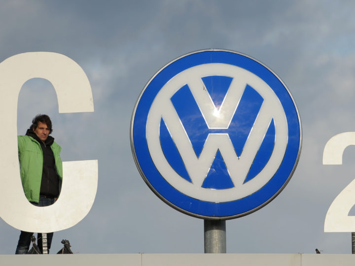 epa05017729 Greenpeace activists on the gate of the  Volkswagen (VW) plant  in Wolfsburg stage a protest using the company logo as part of their slogan: 'CO 2' The problem', in Wolfsburg, Germany, 09 November 2015. Media reports state that the latest emissions scandal at Volkswagen is based on information provided by a VW engineer. The employee of the automaker's research and development department at the company headquarters in Wolfsburg reportedly informed his supervisors about the deception involving carbon dioxide (CO2) emissions at the end of October.  EPA/PETER STEFFEN