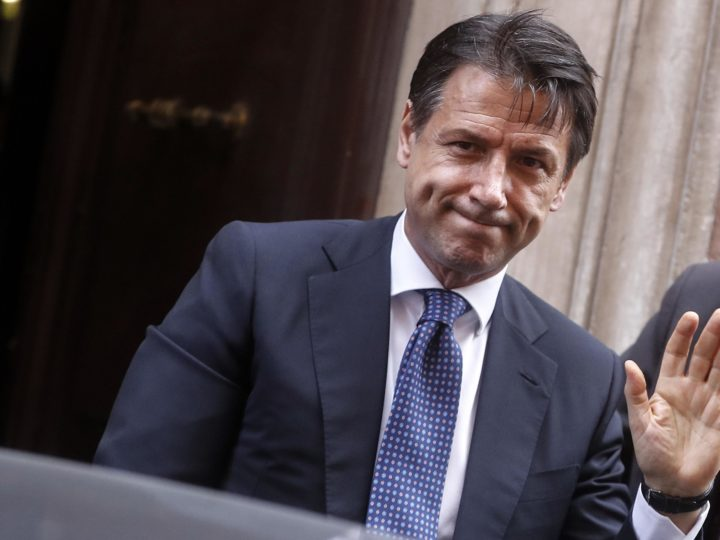 epa07110960 Italian Prime Minister Giuseppe Conte waves as he arrives for a press conference at the foreign press association headquarters in Rome, Italy, 22 October 2018. Media reports were citing Conte as saying before the recent EU Summit that there was 'no room for changes' for the controversial Italian state budget draft and that German Chancellor Merkel had been 'very attentive, very interested, very impressed' by the reform proposals.  EPA-EFE/RICCARDO ANTIMIANI
