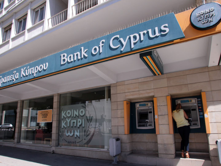 epa04464473 (FILE) A file photo dated 10 September 2013 showing a customer at an ATM of a Bank of Cyprus branch in Nicosia, Cyprus. Bank of Cyprus was one of the banks taking part in the banking stress test of European Central Bank ECB, published on 26 October 2014 and based on 2013 figures. Bank of Cyprus Group on 26 October 2014 said Bank of Cyprus successfully passed the 2014 ECB Comprehensive Assessment following a share capital increase of ?1 bn in September 2014 and further said significant pre-emptive strengthening of the bank?s capital position ensured that the bank was well positioned for the Comprehensive Assessment. In total, 25 Eurozone banks failed a stress test intended to determine their financial stability, the European Central Bank (ECB) said Sunday, adding that 13 of those must raise 10 billion euros (12.7 billion dollars) in the next six to nine months.  EPA/KATIA CHRISTODOULOU