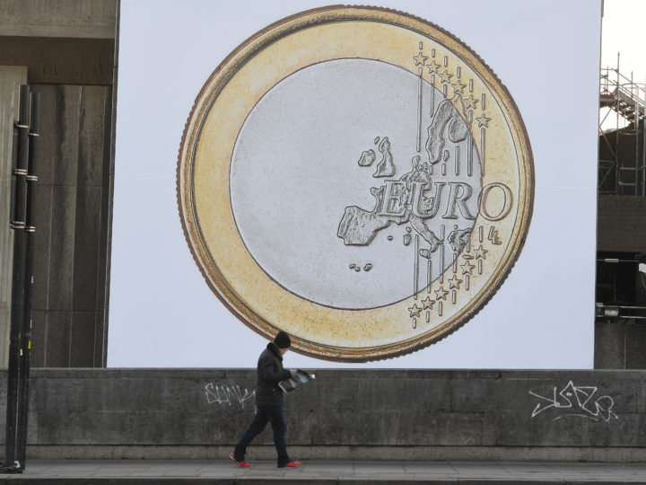 epa05747191 A pedestrians walks past by a giant poster of a Euro coin near Waterloo in London, Britain, 24 January 2017. The government lost its right to trigger article 50 without a parliamentary vote, after the Supreme Court announced an 8-3 verdict against the government. The Supreme Court on 24 January ruled by 8 to 3 that British Parliament must authorize the trigger of article 50 of the Lisbon Treaty in order to initiate the so-called Brexit, to leave the European Union (EU). The large coin poster is a work by Danish artists' collective, Superflex. The work, called Euro (2012), shows a Euro coin with the value removed. It is located on the side of the Hayward Gallery, London until 31 March 2018.   EPA/FACUNDO ARRIZABALAGA