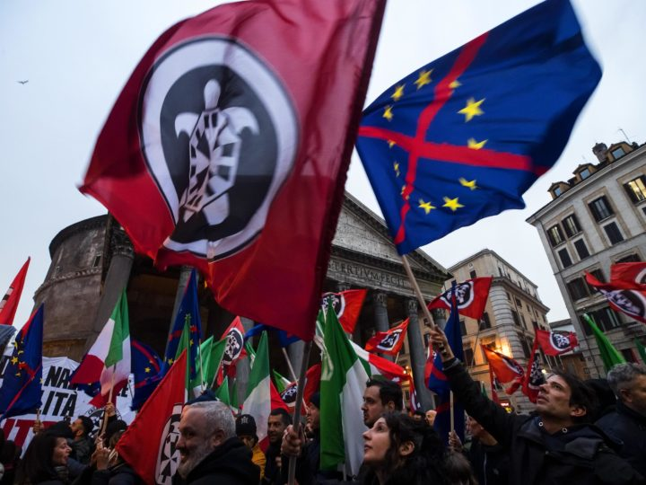 epa06573371 Supporters wave flags during the electoral meeting of far-right movement Casapound in Rome, Italy, 01 March 2018. General elections in Italy will be held on 04 March 2018.  EPA-EFE/ANGELO CARCONI