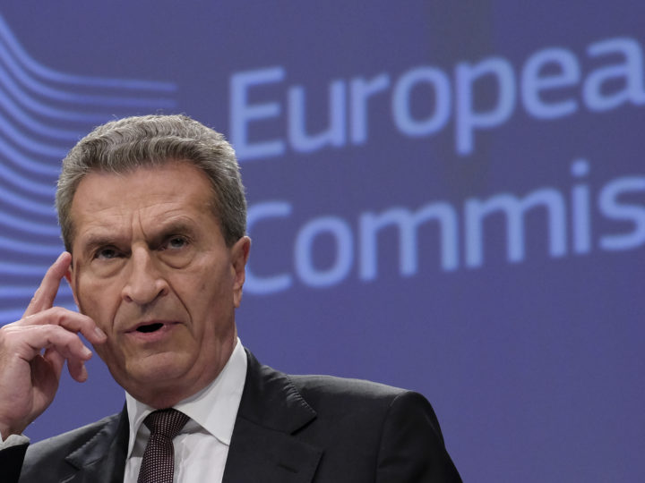 epa07087875 European Commissioner for Budget and Human Resources Guenther Oettinger speaks at a press briefing on the EU budget for the future, on the side of a international conference in Brussels, Belgium, 12 October 2018.  EPA-EFE/OLIVIER HOSLET