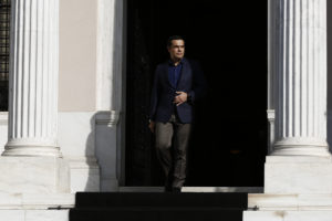 epa07099956 Greek Prime Minister Alexis Tsipras exits his office, Maximos Mansion, to make statements to the press after the resignation of Foreign Minister Nikos Kotzias (not pictured), in Athens, 17 October 2018. Tsipras thanked Kotzias warmly for his contribution to the government and the country in the last 3.5 years. The Prime Minister also announced that he will be taking over the leadership of the foreign ministry in order to assist in the successful conclusion of the Prespes Agreement.  EPA-EFE/YANNIS KOLESIDIS