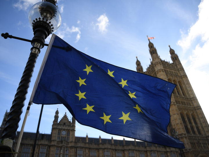 epa07101921 A European Union flag flutters outside the Houses of Parliament in central London, Britain, 18 October 2018. Britain's Prime Minister Theresa May has said: that Britain's transition out of the European Union could be extended by 'a matter of months' to ensure there is no visible border in Northern Ireland.  EPA-EFE/NEIL HALL