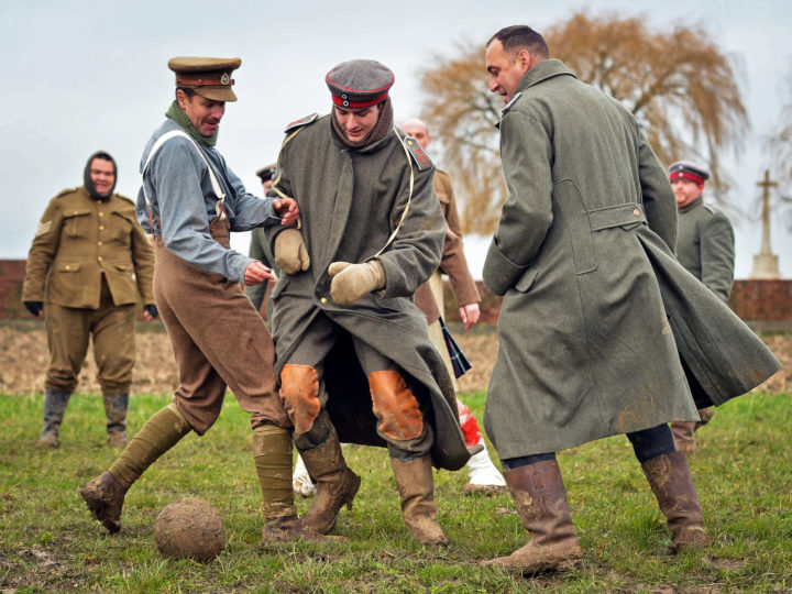 epaselect epa04537193 Men dressed up as German (C) and British (L) soldiers re-enact the no-man's land football match between British and German soldiers, during a re-enactment of the WWI's so-called Christmas Truce in Warneton, Belgium, 21 December 2014. The Christmas Truce was a brief unofficial cease-fire in World War I that took place around Christmas time 1914 between German and British troops.  The year 2014 sees the 100th anniversary of the beginning of WWI, or the Great War, which according to official statistics cost more than 37 million military and civilian casualties between 1914 and 1918.  EPA/STEPHANIE LECOCQ
