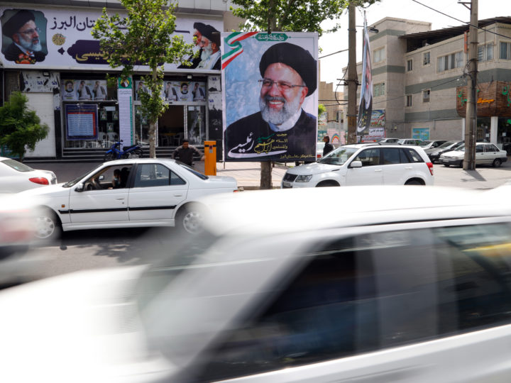 epa05932513 Cars drive past election posters of Iranian presidential candidate Ebrahim Raisi in front of his campaign office, in the city of Karaj, Albroz province, Iran, 28 April 2017. Media reports state six candidates, including current President Hassan Rouhani, are standing for the upcoming elections scheduled for 19 May.  EPA/ABEDIN TAHERKENAREH