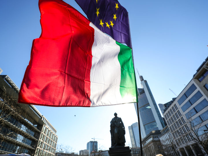 epa06564544 An EU and Italian flag fly over as participants gather in a rally titled 'Pulse of Europe' with theme focusing on the upcoming Italian General election, in Frankfurt Main, Germany 04 March 2018. The citizen's initiative was founded to encourage EU citizens to promote a 'pan-European' identity.  EPA-EFE/ARMANDO BABANI