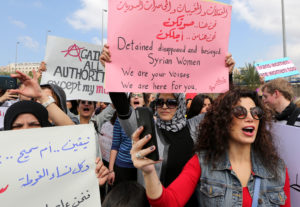 epa06596136 Lebanese women hold placards during a march from the Palace of Justice to the martyrs square to mark the International Women's Day, Beirut, Lebanon, 11 March 2018. Reports state women marched together in Beirut streets, to celebrate International Women's Day and show solidarity under the slogan 'different causes, same struggle'. The crowd carried banners and placards shedding light on some of the struggles women in Lebanon have faced, including refugees from Syria and Palestine and migrant domestic workers.  EPA-EFE/NABIL MOUNZER