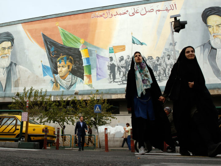 epa07138440 Iranians walk past a mural depicting Iranian supreme leader Ayatollah Ali Khamenei (L, top) and late Iranian supreme leader Ayatollah Ruhollah Khomeini (R, top) in a street of Tehran, Iran, 03 November 2018. US President Donald J. Trump's administration announced on 02 November 2018, that it will reimpose sanctions against Iran that had been waived under the 2015 Iran nuclear deal (the Joint Comprehensive Plan of Action, JCPOA). The US sanctions will take effect on 05 November 2018, covering Iran's shipping, financial and energy sectors. In 2015, five nations, including the United States, worked out a deal with the Middle Eastern country that withdrew the sanctions, one of former US President Barack Obama's biggest diplomatic achievements.  EPA-EFE/ABEDIN TAHERKENAREH