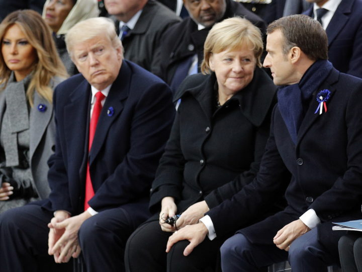 epa07158172 US President Donald Trump (2-L) watches French President Emmanuel Macron (R) putting his hand on German Chancellor Angela Merkel's knee during ceremonies at the Arc de Triomphe, in Paris, France, 11 November 2018. World leaders have gathered in France to mark the 100th anniversary of the First World War Armistice with services taking place across the world to commemorate the occasion.  EPA-EFE/FRANCOIS MORI / POOL MAXPPP OUT