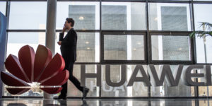 epa07275165 (FILE) - A file photo dated 17 March 2015 mshowing a man walking past a Huawei logo at the world's biggest computer fair CeBIT CeBIT in Hanover,Germany (reissued 11 January 2019). Media reports on 11 January 2019 state security services in Poland have arrested two persons alleged of spying. It is alleged one of the two arrested is a Chinese national, named as Weijing W who works for Chinese telecoms giant Huawei. The Polish man identified by media is Piotr D, who used to work at Polish security services but left following allegations of corruption.  EPA-EFE/OLE SPATA  GERMANY OUT