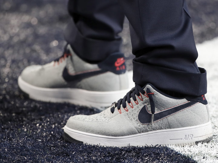 epa06496867 The Nike sneakers of New England Patriots owner Robert Kraft on the field before the start of Super Bowl LII at US Bank Stadium in Minneapolis, Minnesota, USA, 04 February 2018. The NFC Champions Philadelphia Eagles play the AFC Champions New England Patriots in the National Football League's annual championship game.  EPA-EFE/TANNEN MAURY