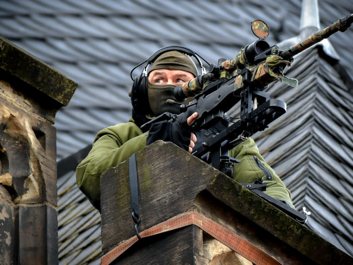 epa07308975 A security sniper keeps watch from a roof during the signing of a new Franco-German friendship treaty in Aachen, Germany, 22 January 2019. French President Emmanuel Macron and German Chancellor Angela Merkel signed a new friendship treaty, intended to supplement the 1963 Elysee Treaty, pledging to provide deeper economic and defense ties and commitment to the EU.  EPA-EFE/SASCHA STEINBACH