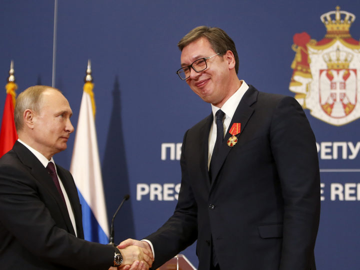 epa07293882 Russian President Vladimir Putin (L) shakes hands with his Serbian counterpart Aleksandar Vucic (R), after being awarded the Order of Alexander Nevsky in Belgrade, Serbia, 17 January 2019. President Putin is on a one-day state visit to Serbia.  EPA-EFE/ANDREJ CUKIC