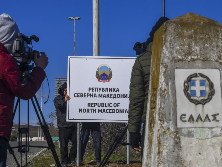epa07366857 Journalists and cameramen next to Greece's border stone and the new country name North Macedonia sign board, at the border crossing Bogorodica between North Macedonia and Greece on 13 February 2019. FYR of Macedonia Government is due change the name of country after ratification of the Protocol of the North Atlantic Treaty for the Accession of Republic of North Macedonia whereby Greece will approve the accession of its northern neighbor to NATO under its new name, as provided by the Prespes Agreement signed by Athens and Skopje.  EPA-EFE/GEORGI LICOVSKI