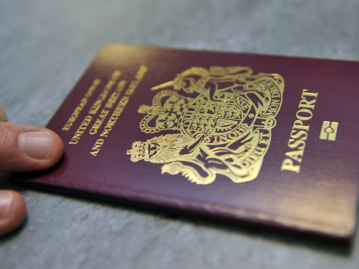 epa02383044 The first new look UK passport was issued in London, Britain, 08 October, 2010. The new passport, which was unveiled in August, contains a number of enhanced security features to keep it from being replicated.  EPA/ANDY RAIN