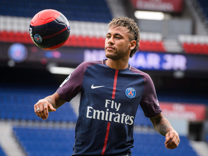 epa06124441 Brazilian striker Neymar Jr. poses for photographs after a press conference at the Parc des Princes stadium in Paris, France, 04 August 2017. Neymar Jr is presented as new player of Paris Saint-Germain (PSG) after completing a record-breaking 222-million-euro move from Spanish side FC Barcelona.  EPA/CHRISTOPHE PETIT TESSON