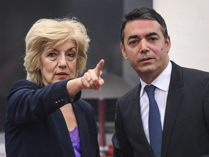 epa07421913 Greece's Alternate Foreign Minister Sia Anagnostopulu (L) and North Macedonian Foreign Minister Nikola Dimitrov (R) as they are signing the agreement to open a new border crossing between Greece and North Macedonia in Skopje, North Macedonia, 08 March 2019. Alternate Foreign Minister of Greece, Sia Anagnostopulu arrived for a two-days working visit to North Macedonia. She will meet top officials in the country.  EPA-EFE/GEORGI LICOVSKI