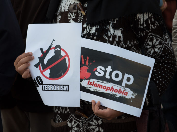 epa07443310 People carry banners and shout slogans during a protest against terrorist attacks on mosque in Christchurch, New Zealand, outside the Parliament building in Rabat, Morocco, 16 March 2019. On 15 March 2019, 49 people were killed by a gunman, believed to be Brenton Harrison Tarrant, and 20 more injured and in critical condition during the terrorist attacks against two mosques in New Zealand during the Friday prayers. Tarrant was charged by one murder charge with more to follow as the investigation continues. Arabic banners read 'No to Islamophobia under any name'.  EPA-EFE/JALAL MORCHIDI