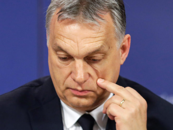 epa07451484 Hungarian Prime Minister Viktor Orban scatches his cheek as he attends a press conference at the end of the European People's Party (EPP) Political Assembly at the European Parliament in Brussels, Belgium, 20 March 2019. The Fidesz party of Orban has been temporary suspended by EPP.  EPA-EFE/STEPHANIE LECOCQ