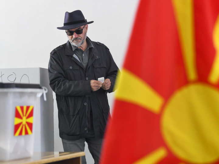 epa07519436 A man casts his ballot during the first round of the presidential elections, at a polling station in Skopje, North Macedonia, 21 April 2019. More than 1.8 million people are elegible to vote in the North Macedonia presidential elections.  EPA-EFE/GEORGI LICOVSKI