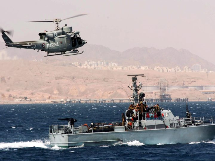 epa000399550 A photograph supplied by the Israeli Defense Forces (IDF) shows an Israeli Navy 'Dabor' patrol boat as it cruises the waters between Eilat and Aqaba, Jordan as a NATO helicpoter flies overhead on Sunday, 27 March 2005.  EPA/ISRAELI DEFENSE FORCES (IDF)
