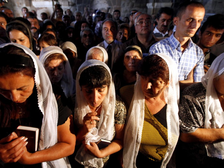 epa02343862 Armenian people pray during a service in the 1,000-year-old Armenian Holy Cross Church, one of the finest surviving monuments of ancient Armenian culture on the Akdamar Island in Lake Van, eastern Turkey, on 19 September 2010. It was the first liturgy after 95 years held in the Holy Cross Church on Akdamar Island.  EPA/TOLGA BOZOGLU