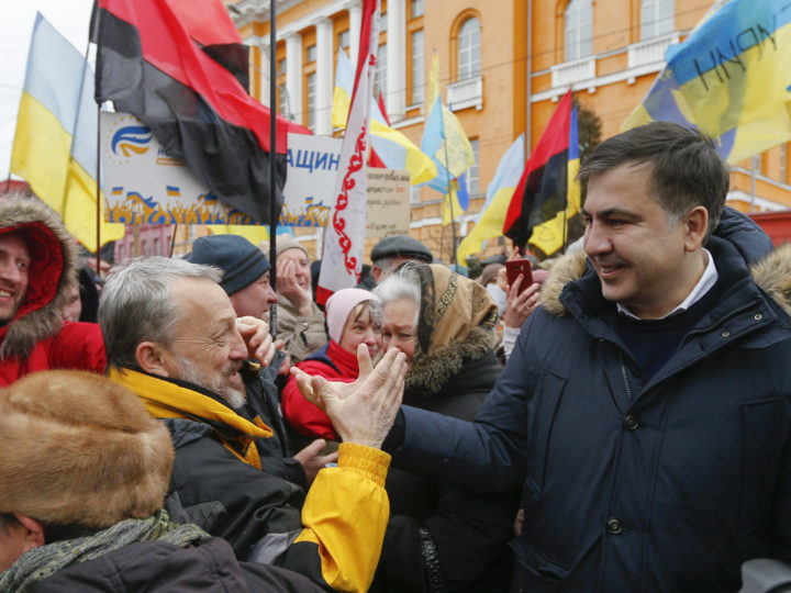 epa06495853 Mikheil Saakashvili (R) greets supporters during their rally in downtown Kiev, Ukraine, 04 January 2018. Protesters and supporters of the former Georgian president and ex-Odessa Governor Mikheil Saakashvili are demanding the Ukrainian parliament to accept a law about the impeachment of the president. Public protests are held since 17 October 2017 with demands for Ukrainian lawmakers being stripped their parliamentary immunity, a modification of the electoral legislation as well as the establishment of a specialized Anti-Corruption Court.  EPA-EFE/SERGEY DOLZHENKO