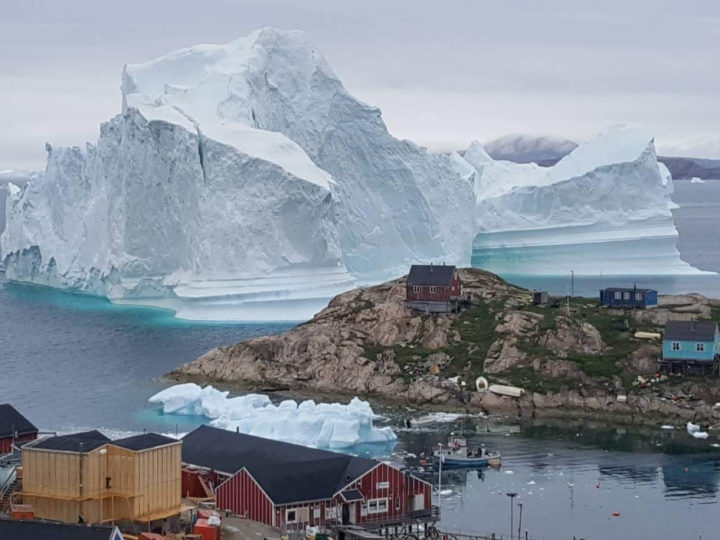 epaselect epa06885114 A general view shows an iceberg stranded near the village of Innaarsuit, in the Avannaata Municipality, northwestern Greenland, 12 July 2018 (issued 13 July 2018). The Avannaata Municipality was alarmed on 11 July, after a huge iceberg was grounded just outside the village of Innaarsuit. According to local media, police asked villagers who live closest to the water, to leave their houses over fears the iceberg could calve and affect the village with a tsunami.  EPA-EFE/MAGNUS KRISTENSEN  DENMARK OUT