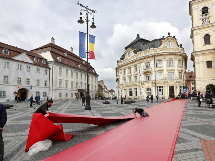 epa07555440 Workers make the final adjustments at the red carpet in the main square of Sibiu city, some 275km north of Bucharest, Romania, 08 May 2019, a day before the start of the Informal Summit of Heads of State or Government of the EU countries.  EPA-EFE/ROBERT GHEMENT