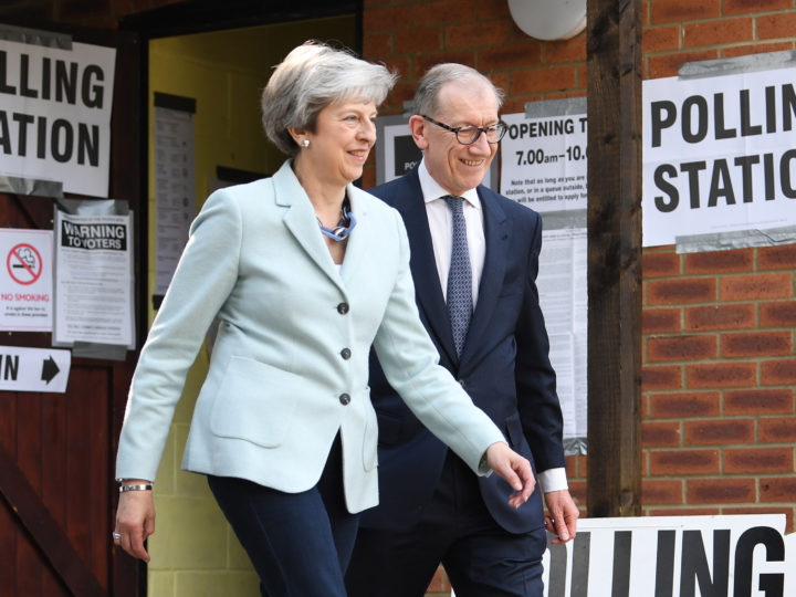 epa07594594 Britain's Prime Minster Theresa May (L) and her husband Phillip (R) cast their vote at a polling station  during the European elections in her Maidenhead constituency in Britain, 23 May 2019. The European Parliament election is held by member countries of the European Union (EU) from 23 to 26 May 2019.  EPA-EFE/NEIL HALL