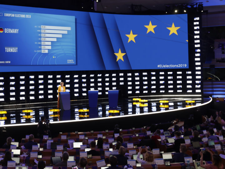 epa07603211 First projections of results of Germany, during European Elections are shown in the hemicycle of European Parliament transformed into a giant TV studio in Brussels, Belgium, 26 May 2019. The European Parliament election is held by member countries of the European Union (EU) from 23 to 26 May 2019. A special electoral evening will take place on 26 at Parliament.  EPA-EFE/OLIVIER HOSLET
