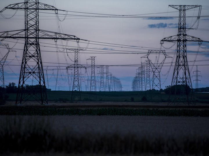 epa06832002 High-voltage electricity pilons are pictured at dusk near Paks, Hungary, 22 June 2018.  EPA-EFE/TAMAS SOKI HUNGARY OUT